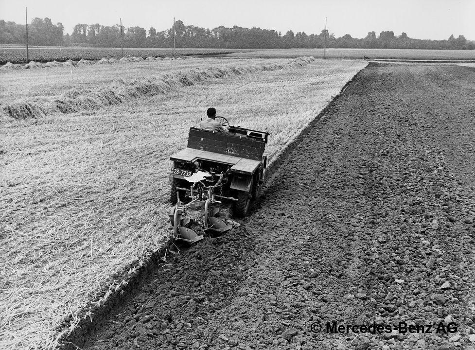 unimog u25 model series 2010 with general purpose plough cultivating soil