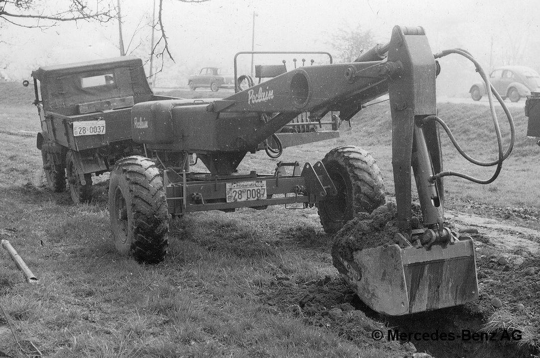 unimog u25, model series 401 with poclain towed excavator