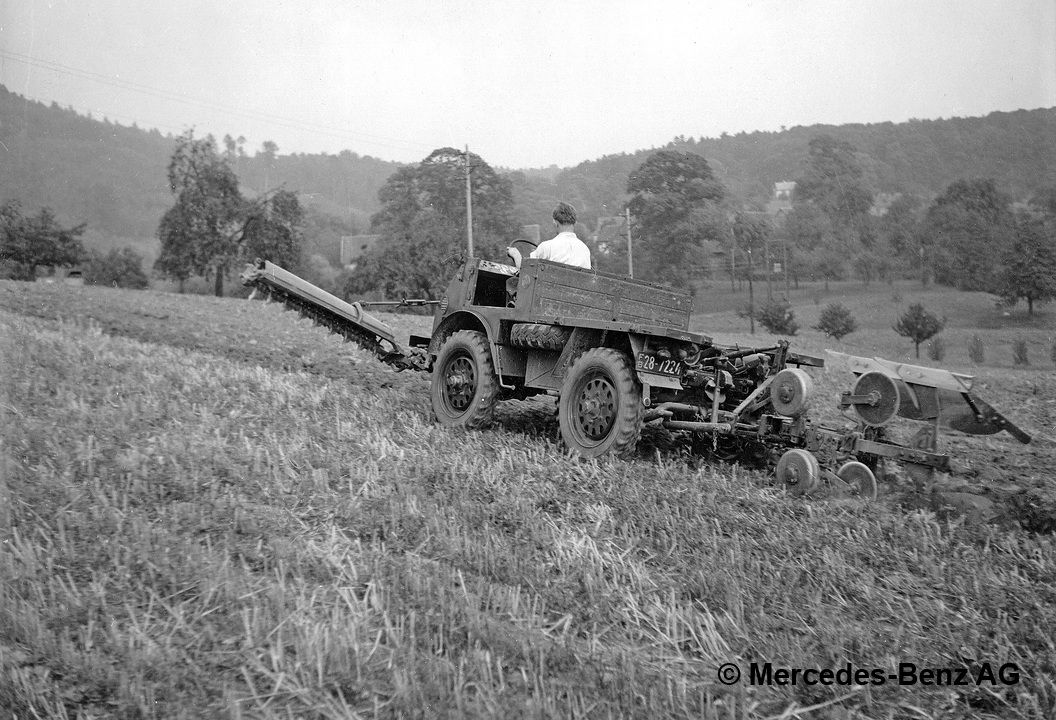 unimog u25, model series 401 with rotary hoe and plough cultivating soil