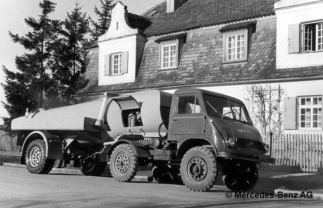 unimog u25, model series 402 tractor unit version with kuka suction:pressure container semi trailer for sewer line cleaning